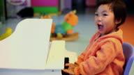 CU Shot of baby girl playing piano / Xian, China