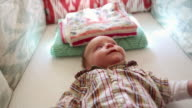 MS Shot of baby lying awake in his crib / Lamy, New Mexico, United States