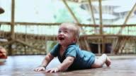 MS Shot of baby trying to crawl / Ubud, Bali, Indonesia