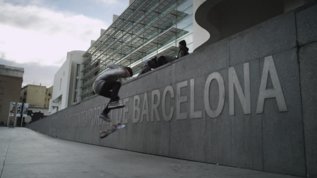 MS LA Shot of Barcelona sign on macba square with skater / Barcelona, Catalunya, Spain