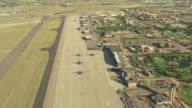 WS AERIAL Shot of base buildings and runway / Colorado Springs, Colorado, United States