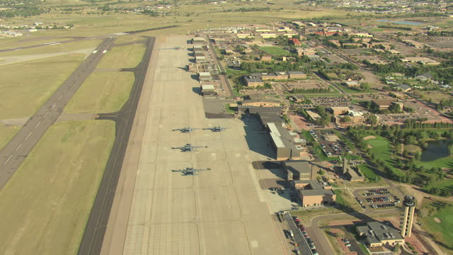 WS AERIAL Shot of base buildings and runway / Colorado Springs, Colorado, United States