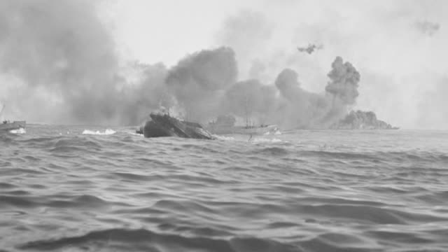 WS Shot of battleship sinking and burning