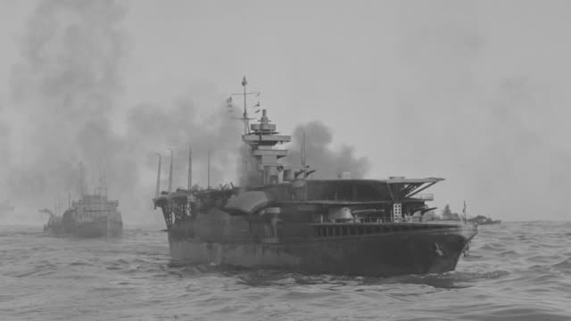 MS Shot of Battleships, aircraft carriers and other boats in ocean under attack as bombs falling from sky Lots of thick black smoke