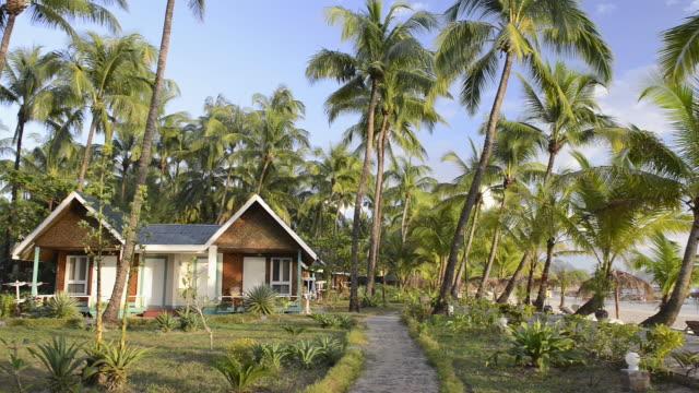 MS PAN Shot of beach Bungalow and Palm trees at sandy beach / Ngapali, Rakhine State, Myanmar