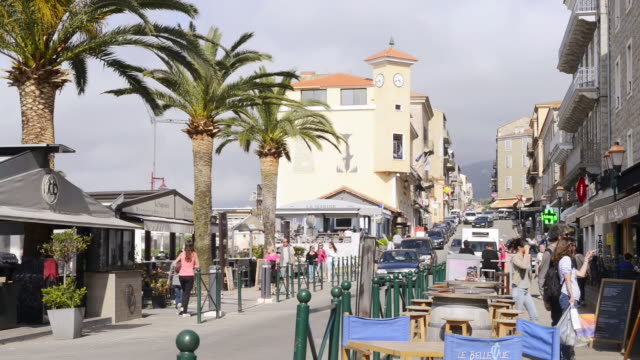 MS Shot of Beach road with restaurants and shops with people / Propriano, Corsica, France