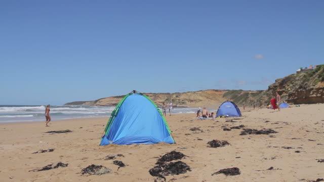 MS Shot of beach tents and bathers enjoying Jan Juc beach / Melbourne, Victoria, Australia