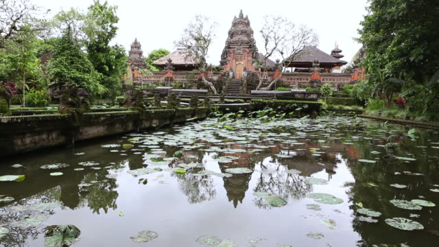 MS Shot of beautiful Indonesian garden filled with religious statues / Ubud, Bali, Indonesia
