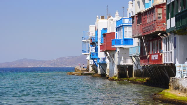 MS Shot of beautiful Little Venice restaurants and bars on water for tourists Greek / Mykonos, Greece