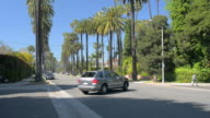 MS TD TU Shot of Beverly Hills street as car drives away / Beverly Hills, California, United States