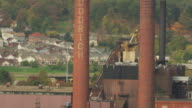 MS TD AERIAL Shot of BF Goodrich factory smokestacks / Akron, Ohio, United States