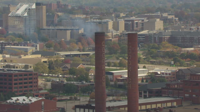 MS ZO AERIAL Shot of BF Goodrich factory smokestacks and downtown / Akron, Ohio, United States