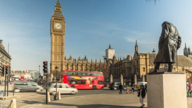WS LA T/L Shot of Big Ben and Houses of Parliament with statue of Sir Winston Churchill at Westminster / London, United Kingdom