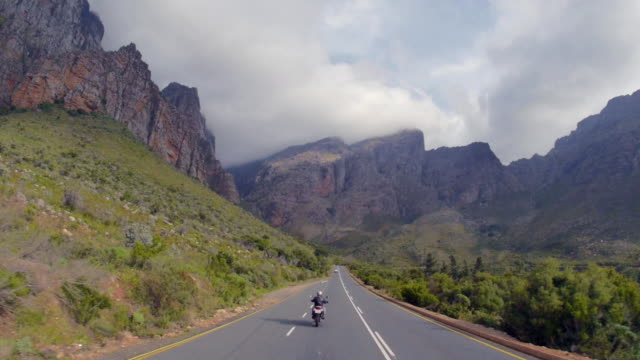 POV shot of biker travelling along mountain pass/ Western Cape/ South Africa