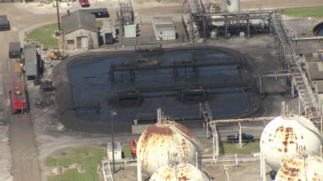 MS AERIAL Shot of black pool at exxon mobil plant / Louisiana, United States