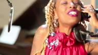 MS TU Shot of black woman singing in recording studio / Santa Fe, New Mexico, United States