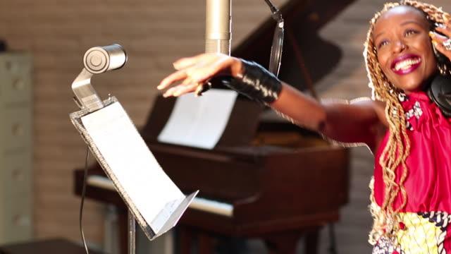 MS PAN Shot of black woman singing in recording studio / Santa Fe, New Mexico, United States