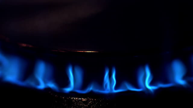 CU R/F Shot of Blue Flame from Gas Cooker / Vieux Pont, Normandy, France