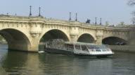 MS Shot of  boat passing under Pont Neuf bridge at Seine river / Paris, Ile de France, France