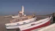 MS Shot of Boats and Almadraba church near Cabo de Gata beach / Monteleva, Andalusia, Spain