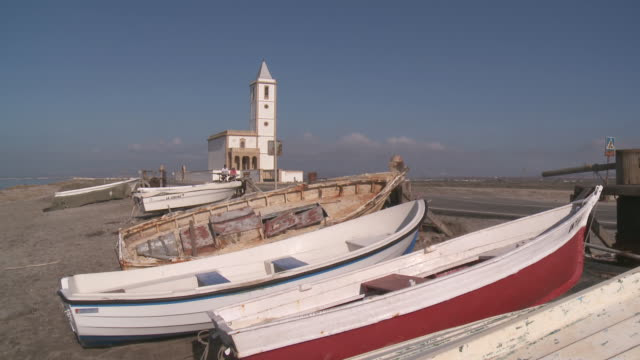 MS Shot of Boats and Almadraba church near Cabo de Gata beach / Monteleva, Andalusia, Spain