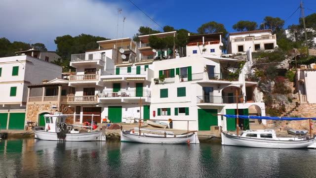 MS Shot of boats at small port near houses / Cala Figuera Mallorca, Balearic Islands, Spain