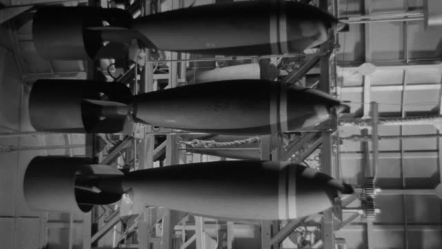 MS Shot of bomb racks as bombs are being prepared to drop