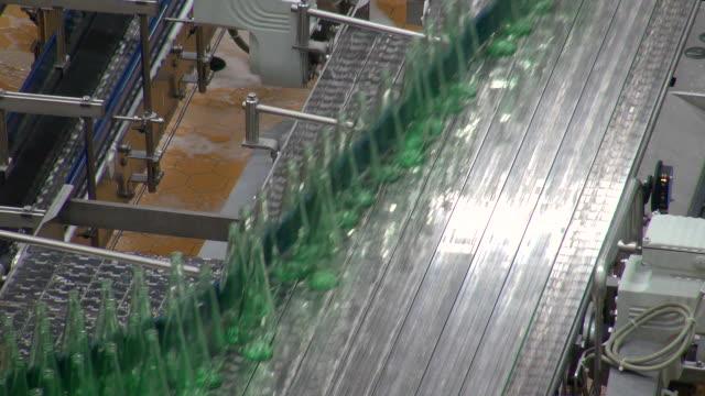 MS Shot of bottle moving in bottling plant at beverage industry / Gerolstein, Rhineland Palatinate, Germany
