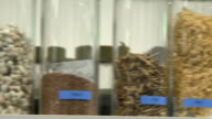 Shot of bottles containing medicinal herbs in a row on the shelf