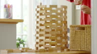 MS T/L Shot of Boy building wooden tower with building blocks / London, Hampstead, United Kingdom