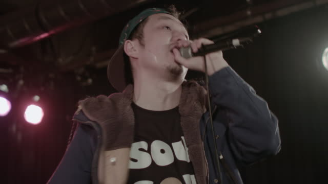MS Shot of Boy singing on stage / shibuya, Tokyo, Japan