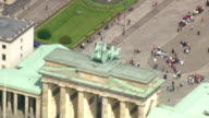 MS AERIAL ZO Shot of Brandenburg gate and walking people with road way / Germany