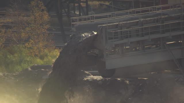 CU AERIAL Shot of bridge unloaded dumping liquid rock at Hull Rust Mahoning Mine / Chisholm, Minnesota, United States