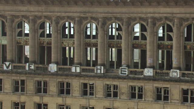 CU AERIAL Shot of  broken windows and graffiti at Michigan Central Station / Detroit, Michigan, United States