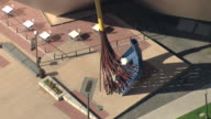 MS AERIAL Shot of broom with pan sculpture and sitting area outside denver art museum in day light / Denver, Colorado, United States