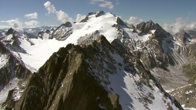 MS AERIAL Shot of Brunnifirn and Oberalpstock / Cavardiras valley, Graubunden, Switzerland