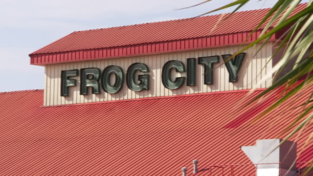 CU Shot of building exterior with sign that says FROG CITY / Rayne, Louisiana, United States