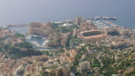 WS AERIAL Shot of buildings and boats on harbor along coast / Monaco, France