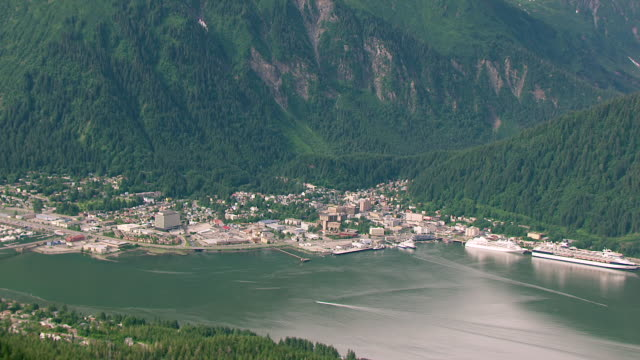 MS AERIAL ZO Shot of buildings and to reveal Gastineau Channel / Juneau, Alaska, United States