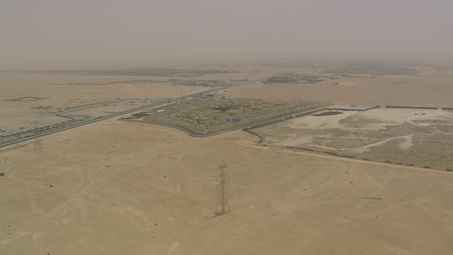 WS AERIAL ZI Shot of buildings construction site at open land in city / Qatar