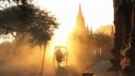 WS Shot of Bullock carts and pagodas at sunset Kingdom of Pagan at sunset / Bagan, Burma