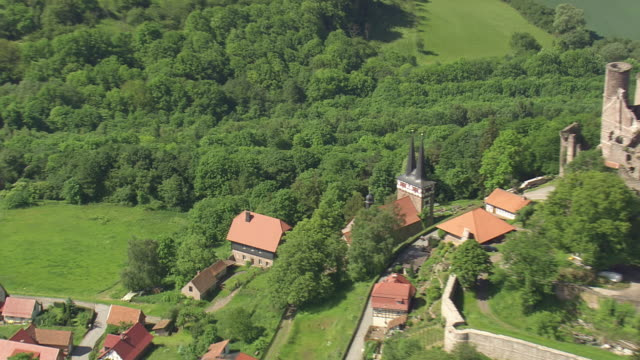 MS AERIAL DS ZO ZI Shot of burg Hanstein castle and houses near Rimbach / Germany