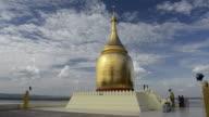 MS Shot of Burmese people in Bupaya temple with golden stupa at Ayeyarwady river / Bagan, Mandalay Division, Myanmar