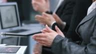LD shot of business hands applauding in meeting room