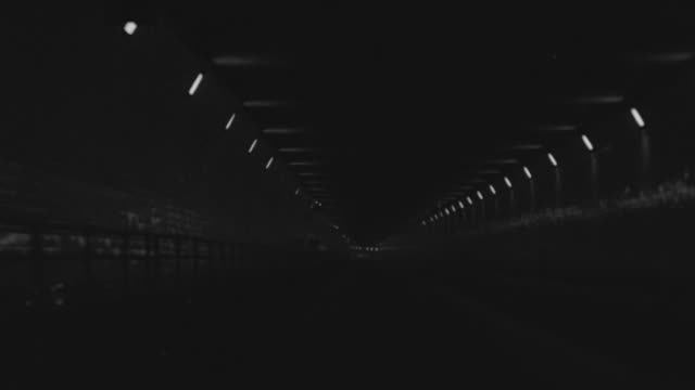 MS POV Shot of car driving through Holland Tunnel under Hudson River