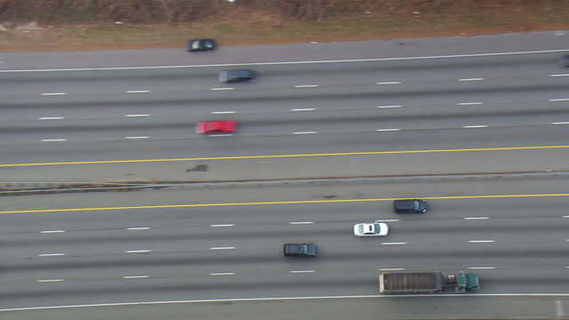 MS AERIAL TS ZI Shot of Car moving on road / North Carolina, United States