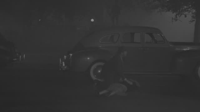 MS POV Shot of car to scatter lady on residential street and people seeing her at foggy night
