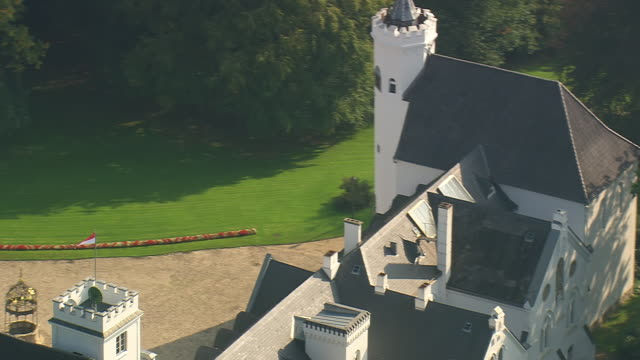 MS AERIAL Shot of castle near Itzehoe with trees around / Germany