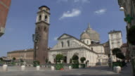 MS Shot of Cathedral, belltower and Chapel of Holy Shroud with street traffic / Turin, Piedmont, Italy