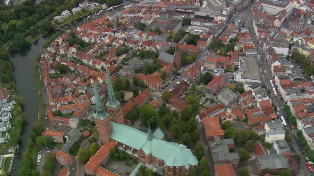 MS AERIAL ZO Shot of cathedral with buildings at Lubeck / Germany